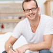 Friendly happy good looking man in glasses — Stock Photo #34575213
