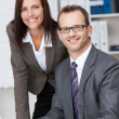 Smiling business manager with his secretary — Stock Photo #34576057