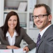 Smiling businessman with a female colleague — Stock Photo