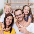 Laughing confident young family — Stock Photo