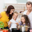 Young family cooking in the kitchen — Photo