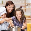 Small brother and sister cooking meal — Stock Photo #34576725