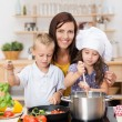 Young brother and sister learning to cook — Stock Photo
