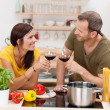 Romantic couple toasting each other in the kitchen — Stock Photo