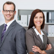 Smiling professional business man and woman — Stock Photo #34577407