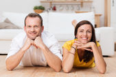 Lazy attractive young couple unwinding at home — Stock Photo