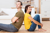 Young couple relaxing on the floor at home — Stock Photo