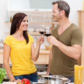 Young couple toasting each other — Stockfoto
