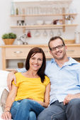 Affectionate couple relaxing on a sofa — Stock Photo
