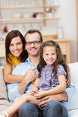 Pretty little girl with her proud parents — Stock Photo