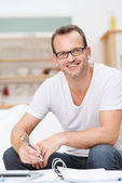 Friendly happy good looking man in glasses — Stok fotoğraf