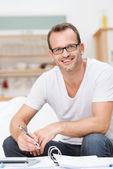 Friendly happy good looking man in glasses — Stockfoto