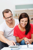 Young couple doing paperwork at home — Stock Photo