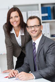 Smiling business manager with his secretary — Stock Photo