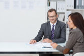Business man and woman in a meeting — Stock Photo