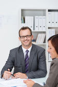 Confident businessman in his office — Stock Photo