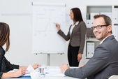 Smiling businessman in a meeting — Stock Photo