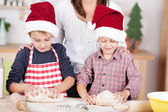 Two little boys learning to bake Xmas cookies — Zdjęcie stockowe