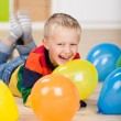 Cute laughing birthday boy — Stock Photo