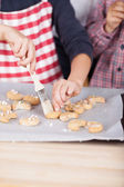 Young child decorating cookies — Stock Photo