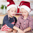 Two little brothers cutting out Christmas cookies — Stock Photo