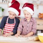 Two cute boys preparing Christmas cookies — Stock Photo