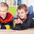 Two small boys watching television — Stock Photo