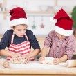 Two young brothers baking Christmas cookies — Stock Photo