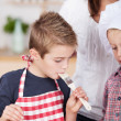 Little boy tasting the baking — Stock Photo