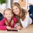 Beautiful little girl with her mother — Stock Photo #34934877