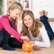 Happy little girl saving her pocket money — Stockfoto