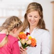 Little girl smelling a flower — Stock Photo #34935421