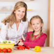 Little girl helping her mother with the cooking — Stock Photo