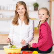 Beautiful young mother and daughter — Stock Photo