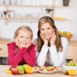 Happy healthy young girl with her mother — Stockfoto