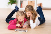 Mother and daughter playing with a tablet — Stock Photo