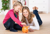Happy little girl saving her pocket money — Stock Photo