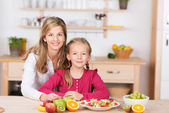 Pretty little girl helping prepare a fruit salad — Stock Photo