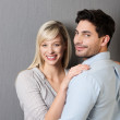 Smiling loving young couple — Stock Photo #34997467