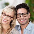 Attractive married couple wearing glasses — Stock Photo #34997721