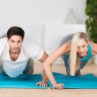 Young couple doing press ups — Stock Photo