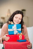 Beautiful woman with gifts — Stock Photo