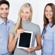 Business team displaying a tablet-pc — Stock Photo