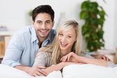 Attractive couple laughing at home — Stock Photo