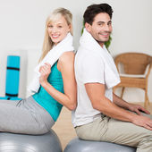 Couple working out with pilates balls — Stock Photo