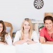 Three teenage students relaxing at home — Stock Photo #35500897
