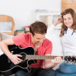 Teenage boy playing guitar music — Stock Photo