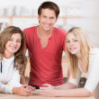 Attractive teenagers relaxing in the kitchen — Stock Photo