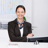 Welcoming friendly receptionist — Stock Photo