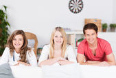 Three teenage students relaxing at home — Stock Photo